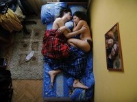 "Jana Romanova photographs sleeping pregnant couples in her series, ""Waiting."""