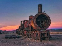 Chris Staring Captured Stunnung Cemetery of Abandoned Trains in Bolivia